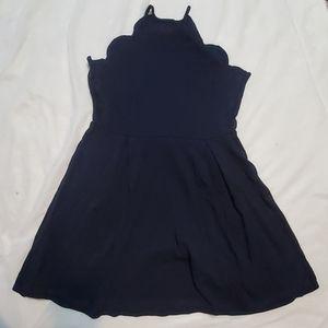 Navy blue skater dress with halter neckline and sc